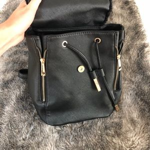 Windsor Bags - Black leather and furry backpack